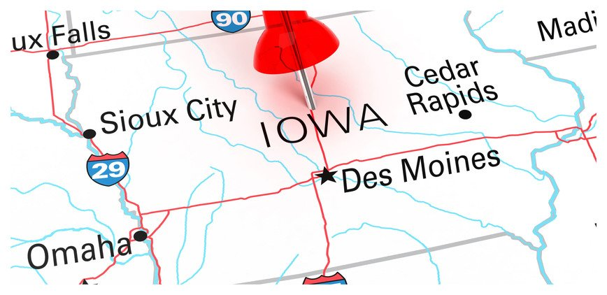Red push pen marking a map of Iowa.